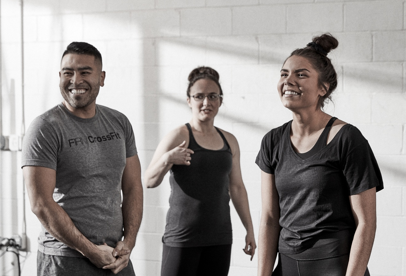 Students at The Firm laugh after a good workout