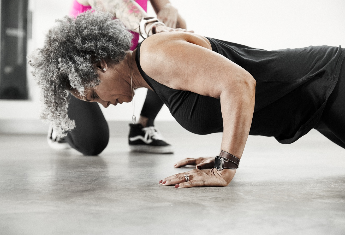 A woman participates in Firm FIT, The Firm's unique training offering
